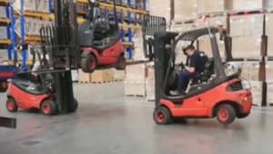 Offloading a forklift with two other forklifts equals one gigantic fail!