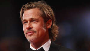 Brad Pitt wearing a suit and tie