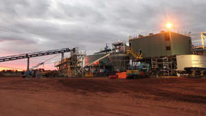 a crane truck on a dirt track: The Harts Range garnet mine is located about 200 kilometres north-east of Alice Springs. (Supplied: Australian Abrasive Minerals)
