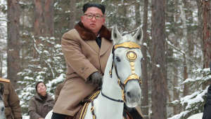 Kim Jong-un riding a horse: This undated picture released from North Korea's official Korean Central News Agency (KCNA) on December 4, 2019 shows North Korean leader Kim Jong Un (C) riding a horse as he visits battle sites at Mount Paektu, Ryanggang.
