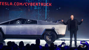 Elon Musk standing in front of a car: Tesla CEO Elon Musk introduces the Cybertruck at Tesla's design studio Thursday, Nov. 21, 2019, in Hawthorne, Calif.