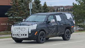 a car parked on the side of a road: 2021 Jeep Wagoneer