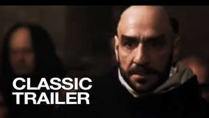 a man looking at the camera: Subscribe to TRAILERS: http://bit.ly/sxaw6h Subscribe to COMING SOON: http://bit.ly/H2vZUn Subscribe to CLASSIC TRAILERS: http://bit.ly/1u43jDe Like us on FACEBOOK: http://goo.gl/dHs73 Follow us on TWITTER: http://bit.ly/1ghOWmt  The Name of the Rose Trailer - Directed by Jean-Jacques Annaud and starring Sean Connery, Christian Slater, Helmut Qualtinger, Elya Baskin, Michael Lonsdale. A pure rational monk yet witty monk, William, and his young trainee, Adso, come to a Middle Age Roman monastery that's experiencing some unusual deaths. As more murders occur William follows the clues leading to the library where the books connected to the murderer have been hidden. Adso meanwhile is stuck between finding the knowledge of the forbidden books and pursuing a forbidden love.  MGM - 1986