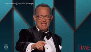 Tom Hanks wearing a suit and tie