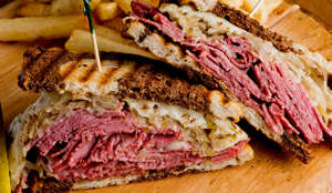 Classic Deli Sandwich, the Reuben. Thinly sliced corned beef, Swiss cheese, thousand island dressing