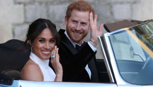 WINDSOR, UNITED KINGDOM - MAY 19: Duchess of Sussex and Prince Harry, Duke of Sussex wave as they leave Windsor Castle after their wedding to attend an evening reception at Frogmore House, hosted by the Prince of Wales on May 19, 2018 in Windsor, England. (Photo by Steve Parsons/WPA Pool/Getty Images)
