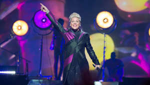 Pink standing in front of a stage