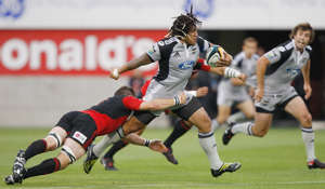 CHRISTCHURCH, NEW ZEALAND - FEBRUARY 27:  Ma'a Nonu of the Hurricanes is tackled by Richie McCaw of the Crusaders during the round three Super 14 match between the Crusaders and the Hurricanes at AMI Stadium on February 27, 2009 in Christchurch, New Zealand.  (Photo by Martin Hunter/Getty Images)