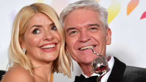 Holly Willoughby, Phillip Schofield are posing for a picture: LONDON, ENGLAND - JANUARY 28: Holly Willoughby and Phillip Schofield pose with the award for Live Magazine Show for 'This Morning' in the winners room attends the National Television Awards 2020 at The O2 Arena on January 28, 2020 in London, England. (Photo by Gareth Cattermole/Getty Images)
