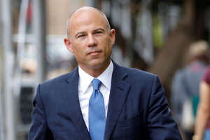 Michael Avenatti wearing a suit and tie: Attorney Michael Avenatti arrives at United States Court in the Manhattan.