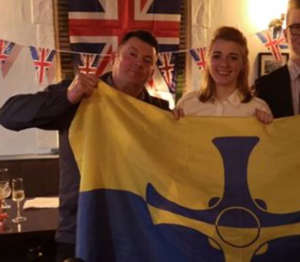 Dehenna Davison and Andrew Foster with a County Durham flag at a party celebrating Britain's exit from the EU
