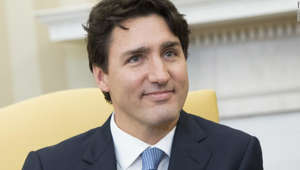 Justin Trudeau wearing a suit and tie smiling at the camera: Canadian Prime Minister Justin Trudeau is pictured during a visit to the White House on February, 2017.