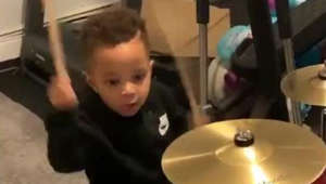 Music obsessed two-year-old has best reaction to brand new drum kit