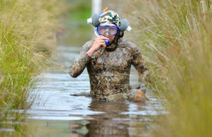 In bog snorkelling, competitors must swim two lengths of a trench without using conventional strokes, though they are equipped with snorkels and flippers. See more on Bing.