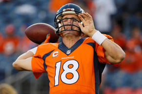 Denver Broncos quarterback Peyton Manning warms up prior to the Broncos' NFL foo...