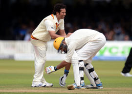 MCC's captain Sachin Tendulkar smiles as Rest of the World's Yuvraj Singh attempts to grab his leg during a cricket match to celebrate 200 years of Lord's at Lord's cricket ground in London, July 5, 2014.