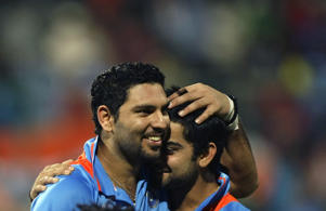 India's Yuvraj Singh celebrates with Virat Kohli after winning the  Cricket World Cup match against Ireland in Bangalore, India, Sunday, March. 6, 2011.