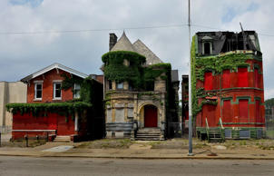 Three of the tens of thousands of abandoned, decaying structures in Detroit that the city is grappling with in its effort to end blight in the city.