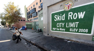 'Skid Row' sign painted on a wall next to the Los Angeles Mission. With AFP Story by Veronique DUPONT: US-CALIFORNIA-POVERTY-HOMELESS == A sign reading 'Skid Row' is painted on a wall next to the Los Angeles Mission, September 22, 2014 in Los Angeles, California. Los Angeles' Skid Row contains one of the largest populations of homeless people in the United States. AFP PHOTO / Robyn Beck (Photo credit should read ROBYN BECK/AFP/Getty Images)