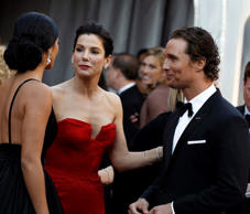Matthew McConaughey and his wife, Camila Alves,talk on the red carpet with Sandra Bullock before the 83rd Academy Awards on Sunday, Feb. 27, 2011, in the Hollywood section of Los Angeles.
