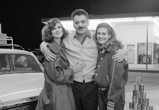 She started her career with the television series 'Crime Story' (1986-88) a guest appearance.In picture: (L-R) Hanna Cox as Lisa Altman, Dennis Farina as Lt. Mike Torello, Julia Roberts as Tracy on the sets of 'The Survivor' episode 19.