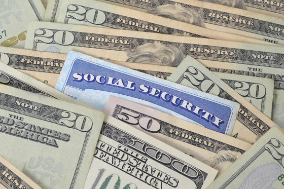 Slide 1 of 11: Social security card and money 178491316