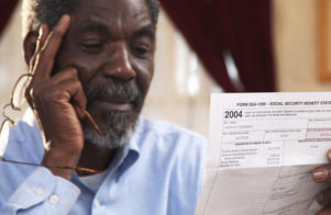 Senior male looking at Social Security documents