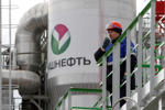 An employee talks on a portable radio set at Bashneft - Novoil refinery in the city of Ufa, April 11, 2013. Middle-sized Russian oil company Bashneft said on Monday net profit increased in 2012 by 4.5 percent, year-on-year, to 52.1 billion roubles ($1.68 billion) on the back of rising production and exports.