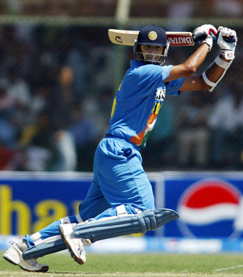 India's Rahul Dravid hits a shot during the first one-day international against Pakistan in Karachi March 13, 2004.