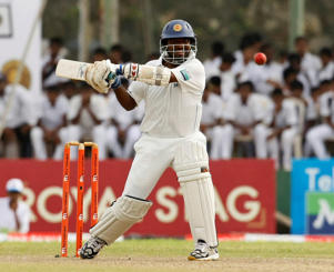 Sri Lankan cricketer Muttiah Muralitharan bats during the third day of the first test cricket match against India in Galle, Sri Lanka, Tuesday, July 20, 2010.