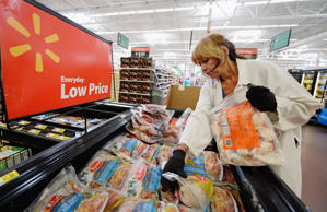 Employee Lucy Rodriguez stocks the frozen meat section of a Wal-Mart Supercenter store on May 30, 2013 in Pico Rivera, California. Kevork Djansezian/Getty Images