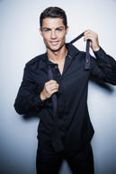 Cristiano Ronaldo poses for photobooth images wearing a shirt from his new collection to mark the global launch of his new CR7 Shirts collection on November 16, 2014 in Madrid, Spain.
