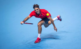 Roger Federer of Switzerland in action in the singles semi-final match against Stan Wawrinka of Switzerland on day seven of the Barclays ATP World Tour Finals at O2 Arena on November 15, 2014 in London, England.