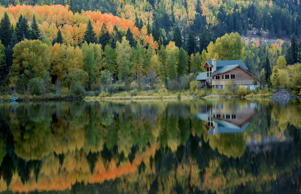 Cabin on Lake Purgatory in the fall in San Juan National Forest area, Colorado