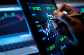 Market Analyze with Digital Moniter focus on tip of finger