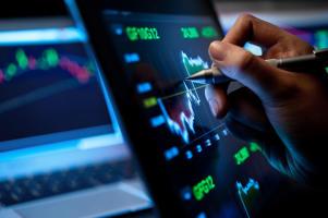 Market Analyze with Digital Moniter focus on tip of finger