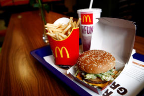 A McDonald's burger, a french fries and a milkshake  at a restaurant in London, U.K.
