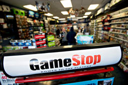 Signage stands in a GameStop Corp. store in Peru, Illinois, U.S., on Wednesday, March 26, 2014.