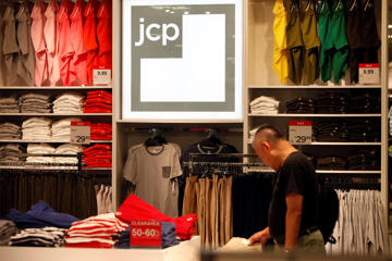 A customers shops in the jcp apparel area at the J.C. Penny Co. store inside the Glendale Galleria shopping center in Glendale, California, U.S., on Friday, August 16, 2013.