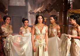 "In this film image released by Disney, Lynn Collins portrays Dejah Thoris, center, in a scene from ""John Carter."""