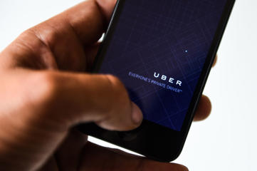 BARCELONA, SPAIN - JULY 01: In this photo illustration, the app 'Uber' is launched in a smart phone on July 1, 2014 in   Barcelona, Spain. Taxi drivers in main cities strike over unlicensed car-halling services. Drivers say that is a lack of regulation   behind the new app. (Photo Illustration by David Ramos/Getty Images)