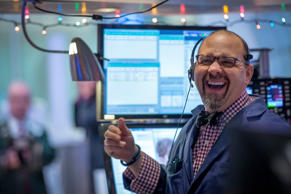 A trader works on the floor of the New York Stock Exchange on December 15, 2014.