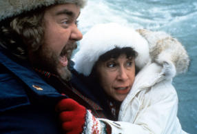 "John Candy died while filming ""Wagon's East"" in March 1994. The film was released five months later. He was also seen in ""Canadian Bacon"" released in 1995. (Pictured)  John Candy and Rhea Perlman in a scene from ""Canadian Bacon""."