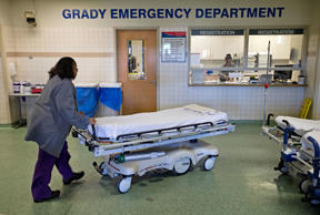 In this Friday, Jan. 24, 2014 photo, a worker wheels beds through the emergency department at Grady Memorial Hospital, in Atlanta.