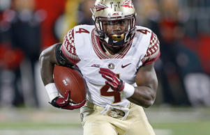 Dalvin Cook of the Florida State Seminoles runs with the ball against the Louisv...