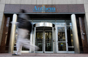 A pedestrian walks past the corporate headquarters of health insurer Anthem, for...