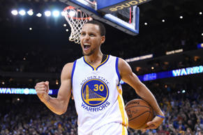 Golden State Warriors guard Stephen Curry celebrates after the game against the Orlando Magic on Dec. 2, 2014, in Oakland, Calif.