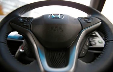 An airbag logo is seen on a steering wheel of Honda sedan, which has an airbag made by Takata Corp, photographed in Tokyo on December 1, 2014.