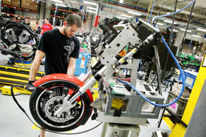 A worker builds the front end of a 2015 Victory Cross Country motorcycle on the assembly line at the Polaris Industries factory on August 8, 2014 in Spirit Lake, Iowa.
