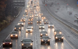 Heavy holiday traffic travels through wintry conditions on I-495 in Landover, Maryland on November 26, 2014.